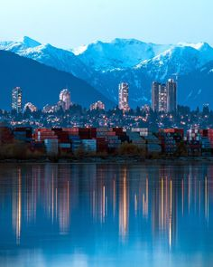 Metropolis . Last night's blue hour over Metrotown in Metro Vancouver. Looking over the south arm of the mighty Fraser River at shipping containers on the shores of Richmond over Burnaby to Mt. Seymour in North Vancouver (on the left) and beyond to snow covered Mt. Bonnycastle (just north of Indian Arm. Captured from Deas Island in Delta just south of Vancouver British Columbia Canada April 15 2017