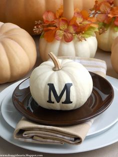 monogrammed pumpkins for Thanksgiving table.