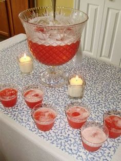 2 packets of Fruit Punch Kool-Aid  1 c. boiling water  2 qts. warm water  2 1/2 c. sugar  1-46 oz can of pineapple juice   2-2 liter bottle ginger ale, chilled