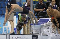 The United States' Ryan Lochte dives into the pool for the final leg of the Men's 4X100 meter Freestyle Relay as teammate Michael Phelps, right, looks on at the Aquatics Centre in the Olympic Park during the 2012 Summer Olympics in London, Sunday, July 29, 2012. The United States won the Silver Medal after taking second place to France. (AP Photo/Matt Slocum)