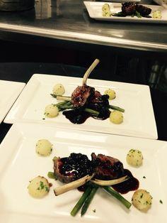 Dijon herb lamb chops with Parisienne potatoes, asparagus spears, and a dark cherry demi-sauce - Bellatrix Restaurant on the Classic Club golf course - Palm Desert, CA