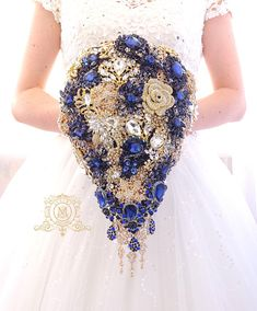 Check out this item in my Etsy shop https://www.etsy.com/listing/510527121/navy-blue-and-gold-brooch-bouquet