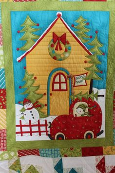 Christmas quilt, pieced and quilted by Chris Gamache.  MQ Resource.