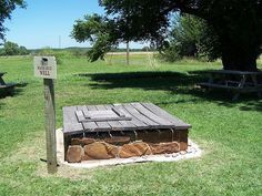 Pa's hand dug well was the key to locating precisely where the Ingalls family lived on the southeastern Kansas prairie. Laura's descriptions from the book Little House On The Prairie were used to recreate the cabin. Near Independence, KS.