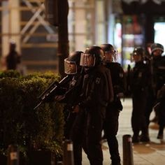 Armed Police block Champs-Elysees avenue after shots were fired