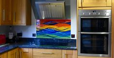 The design of this bespoke glass splashback from a home on Hayling Island is an incredibly colourful wave, marrying Carnivale inspired colours to a beautiful and classic fused glass design. Cascading waves on the foreground mix with shifting layers of vibrant wave shaped gradients in the background, and the end result is this highly personalised centrepiece. It really injects a strong and vivid burst of life into the kitchen! Glass Design, All Design, Hampshire House, Splashback, Fused Glass Art, Panel Art, Bespoke, Wave, Layers