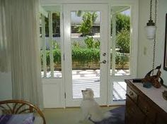Dog door in side lite  http www eleganceentries com Patio french back doors with internal mini blinds and pet doggy  . French Door With Dog Door Built In. Home Design Ideas