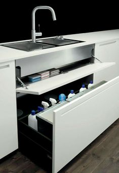 Pull out bins for rubbish rather than an open cupboard bin. Top to have actual pull out compartments rather than this.