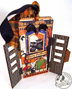Gorgeous tag by Jim, The Gentleman Crafter! This stunning Graphic 45 Happy Haunting tag has little doors that swing open to reveal and beautiful Halloween scene!