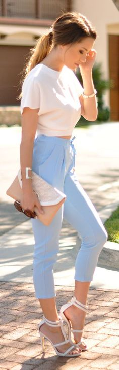 Pair your Baby Blue Cigarette Pants with a cream white crop top and ankle strap heels for a clean yet chic look! Don't forget your nude clutch to tie the look together