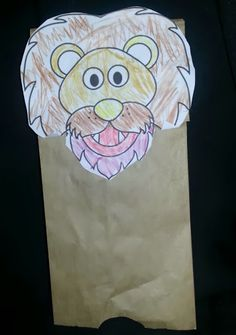 Creating a lion from a paper bag and printout. Daniel in the Lion's Den.