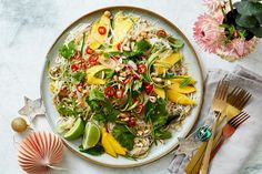 Feed a hungry crowd with our festive mango and chilli-pickled cucumber noodle salad.
