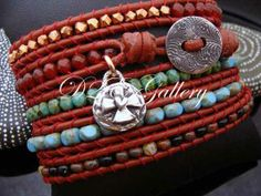 D2E hand loomed assorted mixture of picasso glass, carnelian, sterling silver, and copper, on red leather. by D2Egallery, $140.00
