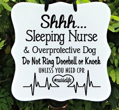 Let Your Sign Shine! A perfect way to kindly convey that there is a Nurse quietly sleeping with an overprotective dog at the residence. Wonderful gift for any Nurse! This genuine wood sign is painted snow white with raven black vinyl lettering. Finished with a sheer black ribbon hanger. In-stock