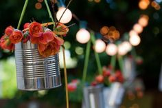 Flowers in repurposed tin can vases