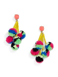 A colorful pom pom fringe is a whimsical take on tassel earrings. For an elevated, effortless look style with a crisp blouse.