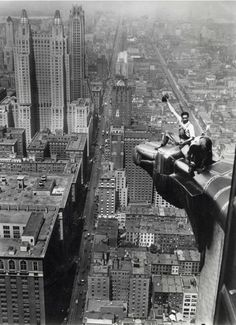 High above New York two cleaners clean a corner ornamentation eagle of the Crysler Building, 1932