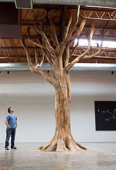 Here's one of Henrique Oliveira's fascinating art installations made of scrap wood.