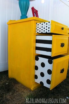 Awesome dresser makeover with stenciled drawer sides for a punch of fun! from A Girl and A Glue Gun