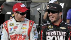 Dale Earnhardt, Jr. talks with Martin Truex, Jr., before qualifying for Sunday's #NASCAR Sprint Cup series auto race at Charlotte Motor Speedway