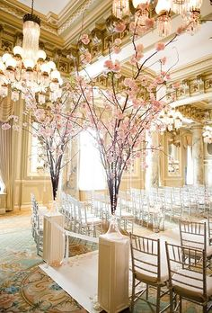 Cherry blossoms and crystals welcome a bride down the aisle http://www.brides.com/wedding-ideas/wedding-flowers/2015/07/wedding-flower-meanings