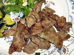BULKOGI (Korean Barbecue)   2 pounds top sirloin steak   5 tablespoons soy sauce   1/4 cup sweetener   1/4 teaspoon black pepper   1/4 cup green onion, chopped   1 tablespoon garlic, minced   1 tablespoon sesame oil   5 tablespoon water
