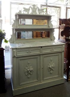 "Beautiful painted French server with marble top and mirrored back.20""D x 48.5""W x 74""H"