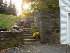 These stone steps and retaining walls tame a very steep slope.