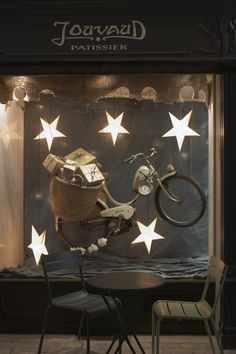 "From Provence, ""Jouvaud Patissier"" whimsical store window display with flying bicycle, Carpentras, France #retail"