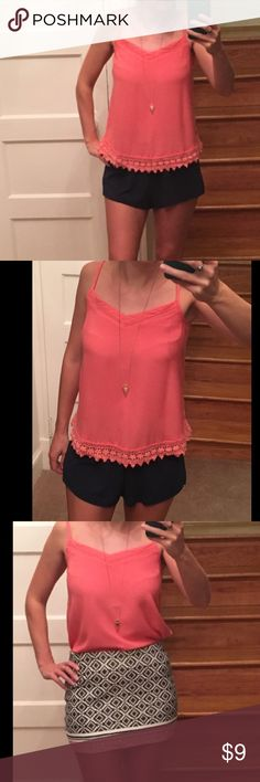 Coral top with lace detail on bottom size 2-4 Very pretty peach / coral colored shirt. Brand is New Look (purchased in London). Worn once so perfect condition. Fits Size 2-4. New Look Tops Camisoles