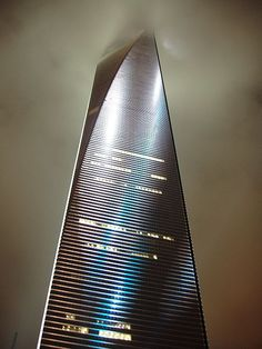 The Shanghai World Financial Center in China is one of the tallest buildings in the world. Built in 2008, it reaches 492 metres (1614 feet) in height and contains 101 floors. The skyscraper is used for a number of uses, from shopping malls, to hotels, offices and conference rooms. This image shows the building rising into the cloudy night sky.