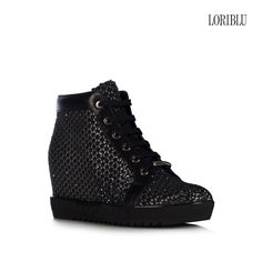 Black python print suede wedge sneaker. The original pattern, joined to the hand-applied SWAROVSKI ELEMENTS, will add an incomparable dash of elegance to your casual outfit.