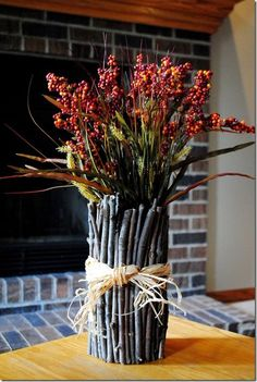 an idea to use all the sticks my son has gathered | NEATO IDEA ... i do this w/dried flowerz i collect from flowerz mY kidz gimme SAVE SAVE SAVE (✯