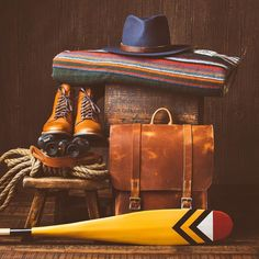 Adventure Ready!  Boots @thursdayboots  Blanket @woolrichinc  Bag @stockandbarrel  Canoe Paddle @sanborncanoe  Binocular strap @bellandoak  Hat @whislercivilian All leather @horweenleather  #thingsneatlyorganized #thingsorganizedneatly #thingsarrangedneatly #boots #leathergoods #bag #manandbag #bags #rustic #reclaimedwood #vsco #patina #horween #horweenleather #bellandoak #highadventure #details #detailedgent #woolrich #sanborncanoe #canoe #design by brandonburkphotography