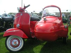 Red Vespa with a side car :)