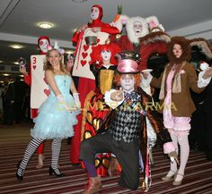 Alice in Wonderland corporate entertainers to hire across the UK - Mad March Hare, Alice, Red Queen, Crystal Ball Red Cards, White Rabbit bouncy stilt, Red Card Stilt and the nasty Red Queen herself. Alice In Wonderland Characters, Alice In Wonderland Party, Corporate Entertainment, Entertainment Ideas, White Queen Costume, Queen Alice, Costume Ideas, Costumes, Circus Performers