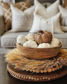 Fall neutral farmhouse home interior decor. fall living room. fall coffee table decor. Pumpkin decor. Modern industrial farmhouse.
