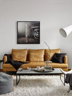 Tanned leather sofa in Scandinavian style living room