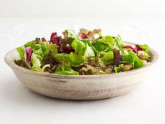 Thinly sliced shallots are mixed into a warm mustard vinaigrette. Toss with mixed greens and serve.
