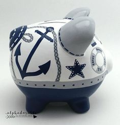 This navy and grey nautical personalized piggy bank is created with porcelain ceramic and is completely hand painted using the highest quality acrylic paint. The art is forever protected by a glossy diamond finish glaze. Each piggy bank is hand painted especially for you on an individual