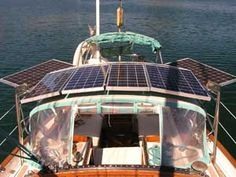 Dollars & Sense of Solar Panels -- we ended up with 453 watts of solar and loved every single one of them.  More on deciding if an upgrade is right for your boat -- from http://theboatgalley.com/dollars-sense-solar-panels-blue-water-sailing-february-2005/
