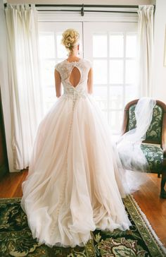 gorgeous ivory flowing ballgown #wedding dress with sleeves and peekaboo back