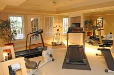 home workout room | The Lloyd home has a nicely-equipped exercise room, featuring the ...Oh id love to do this to my basement!