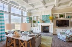 Built in look on either side of fireplace and off set TV with different configuration of shelving House of Turquoise: Highland Custom Homes