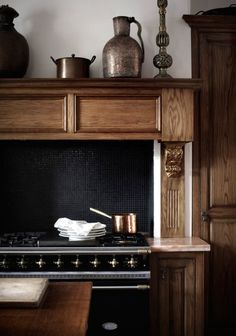black stove + black tile backsplash trimmed with wood (Sharyn Cairns Kitchen Dining, Kitchen Decor, Kitchen Stove, Wooden Kitchen, Kitchen Ideas, Dining Room, Prefabricated Houses, Beautiful Kitchens, Ideal Home
