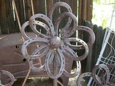 Country yard ornaments...horseshoe flowers