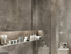 Very chic and modern bathroom. We love how the tile in the shower gives off a glittering effect!