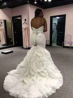 The dress is absolutely beautiful. It was ordered in white and has never been worn. The dress has the most figure FLATTERING shape. It is a mermaid dress. The bottom is full of beautiful flowers. The belts that are shown on the photo are not on the dress.