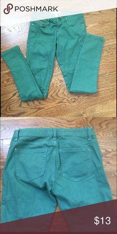 Adorable skinnies Aqua marine colored adorable skinnies, vibrant color is perfect for spring/summer with your favorite pair of sandals. Front zipper pocket detail, 24 inch waist, 28 1/2 inch inseam. Excellent condition. Jeans Skinny
