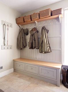 Bespoke boot room with various storage solutions with coat hooks, storage boxes, cupboards and lead hooks. Perfect for the family.
